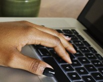 cropped-cropped-black-woman-hand-on-laptop-createherstock.jpg